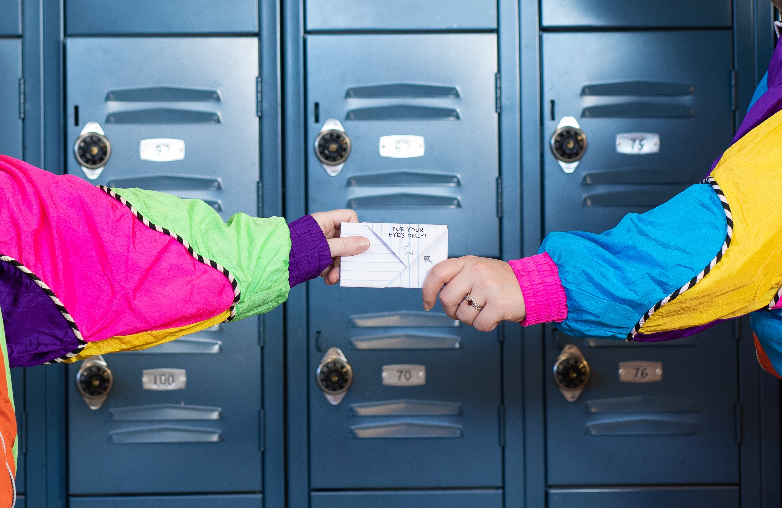 folded marketing campaign letter handing off in front of lockers