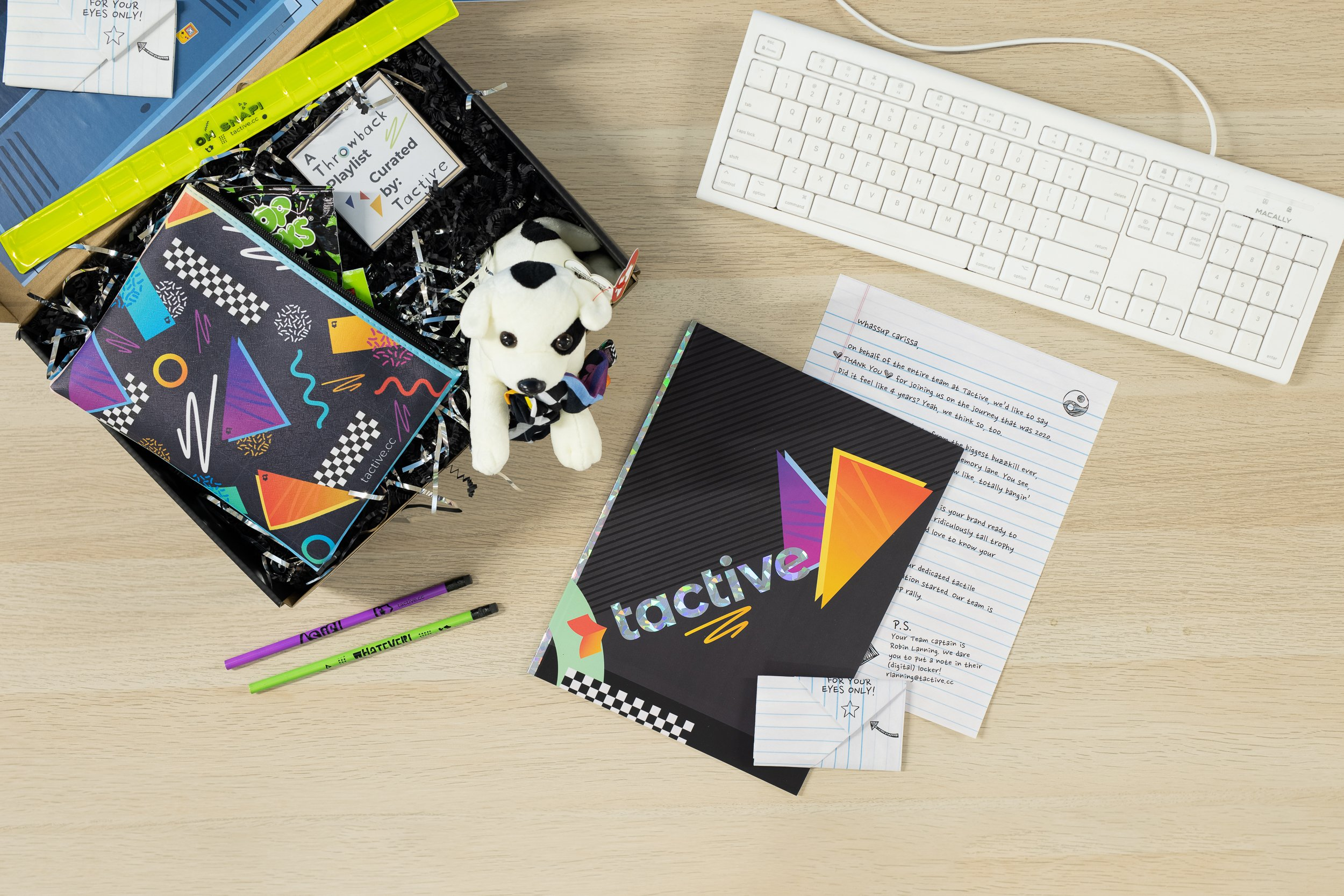 90s themed marketing campaign kit with yearbook, letter, and custom stuffed dog
